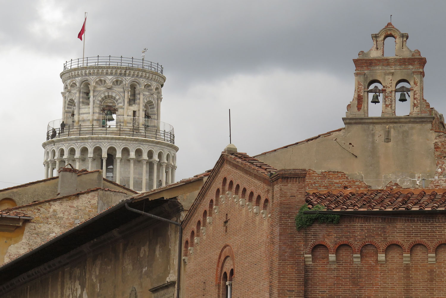 Italy-Pisa-Leaning-Tower-Seen-From-Town