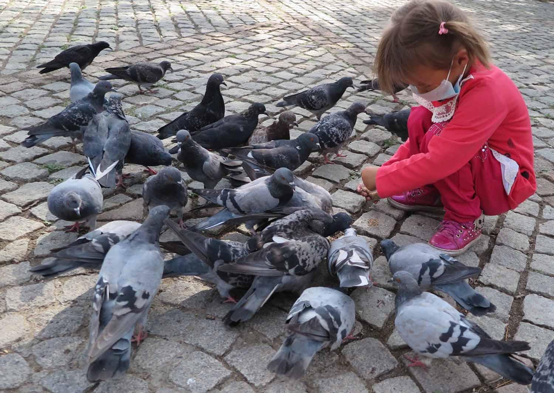 Mongolia-Ulanbator-Street-Scenes-Girl-Pigeons