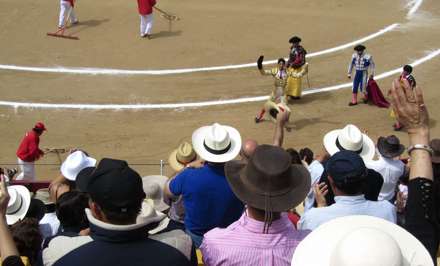 Ecuador-Quito-Bullfight-Hats-Flowers-Wineskins
