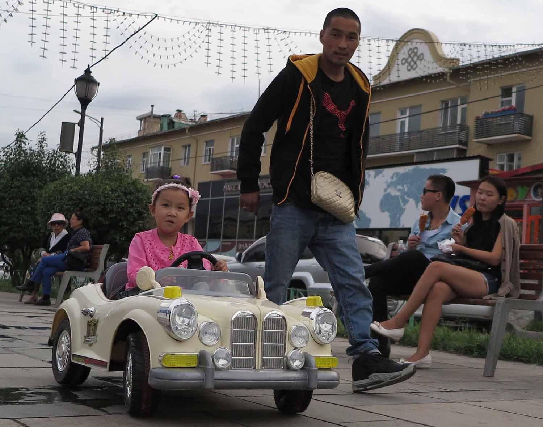 Mongolia-Ulanbator-Street-Scenes-Girl-Driving