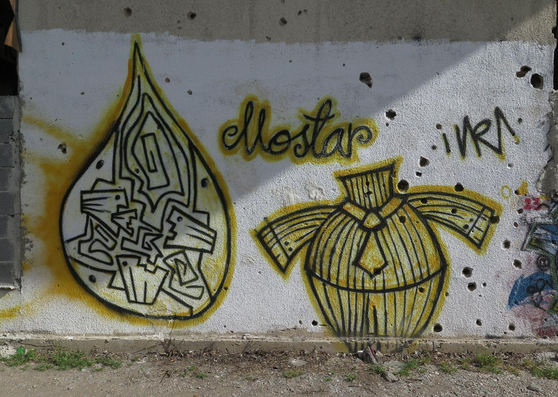 Bosnia-Mostar-Bullet-Holes-Graffiti